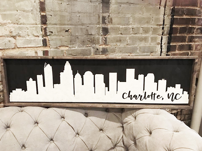 city skyline silhouette framed sign