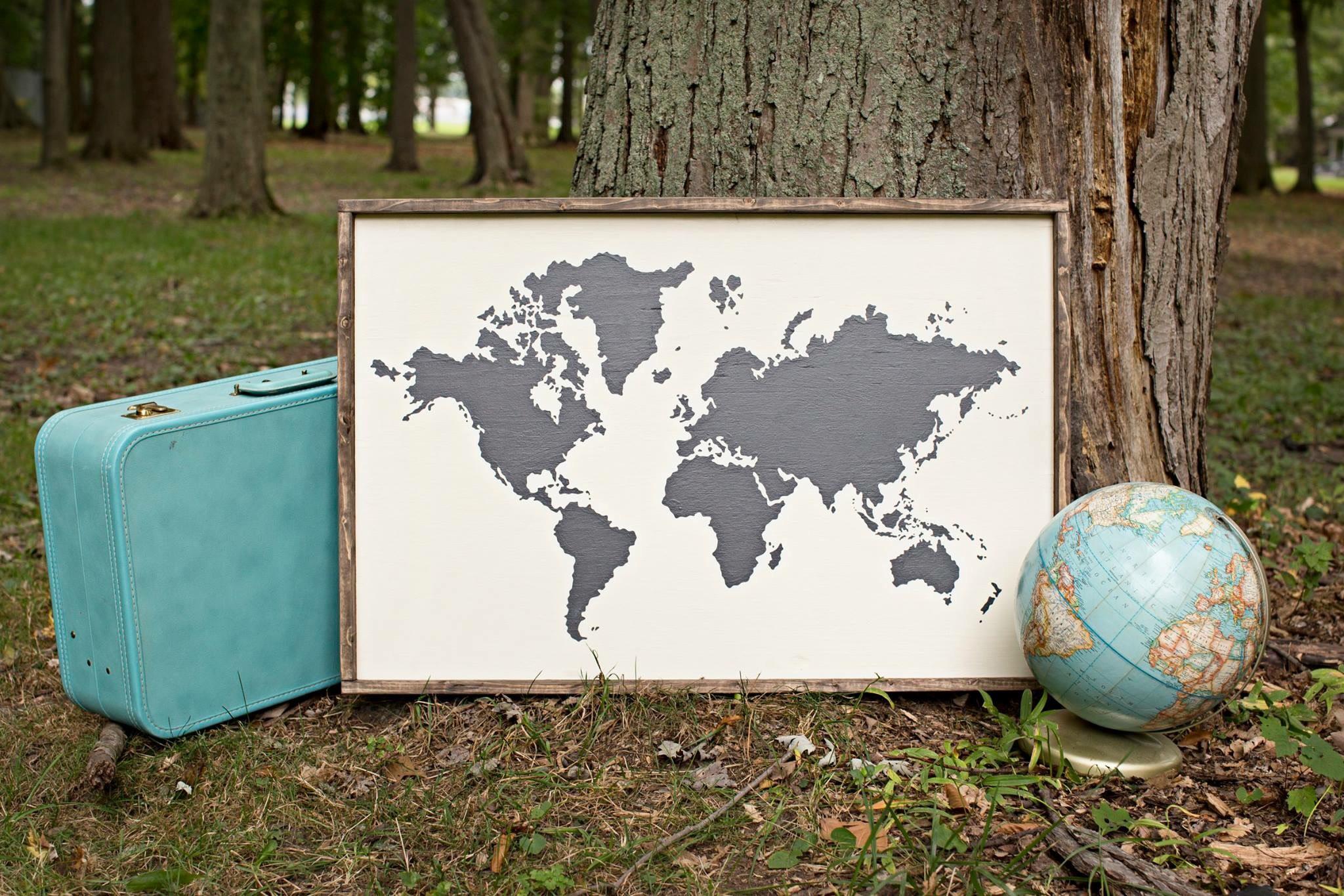 world map silhouette framed sign