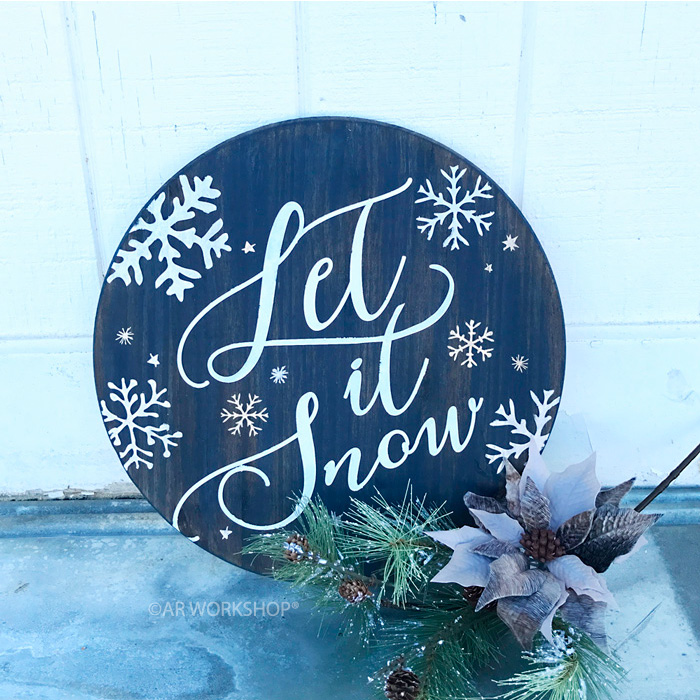 wintery let it snow round sign