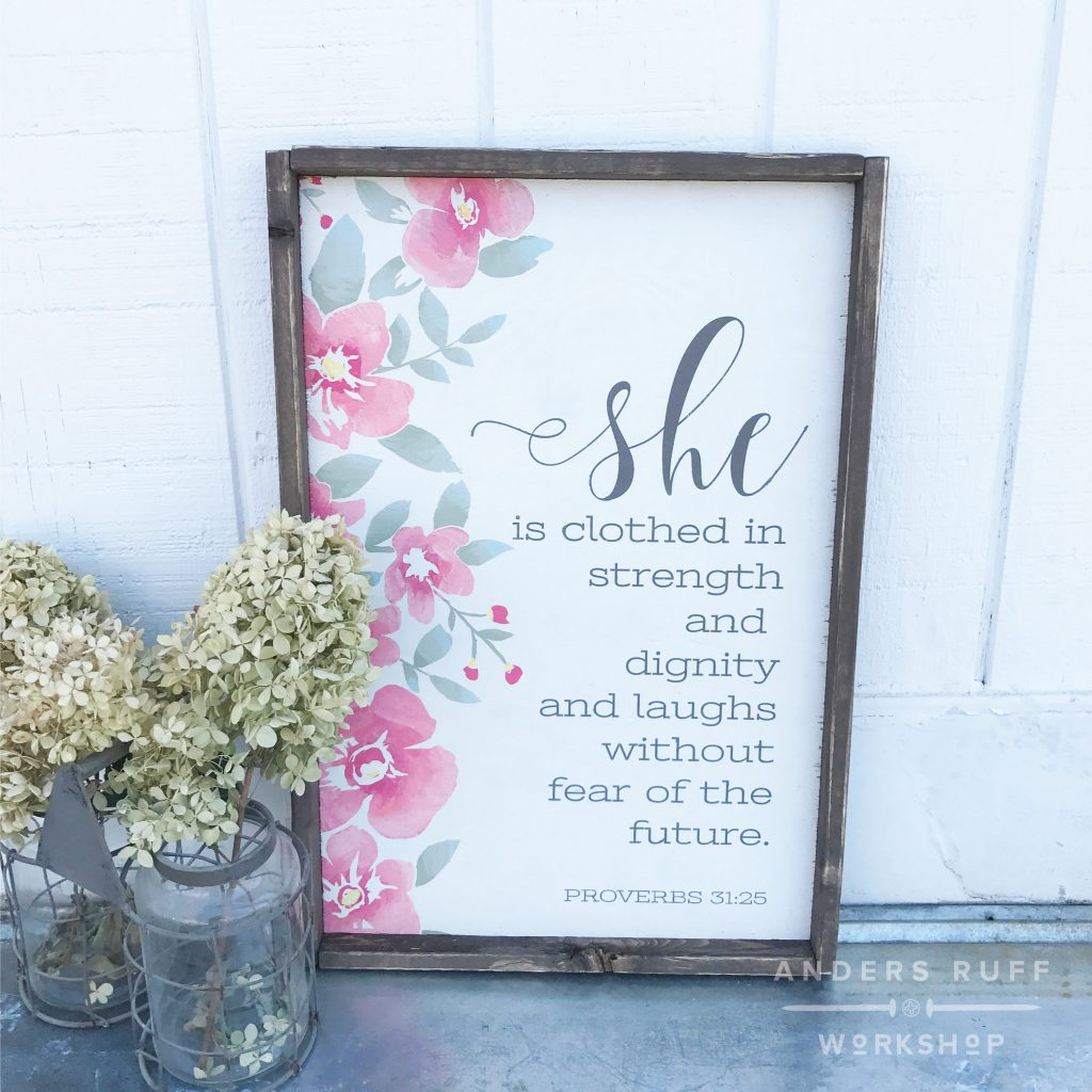she is clothed in strength oversized framed sign
