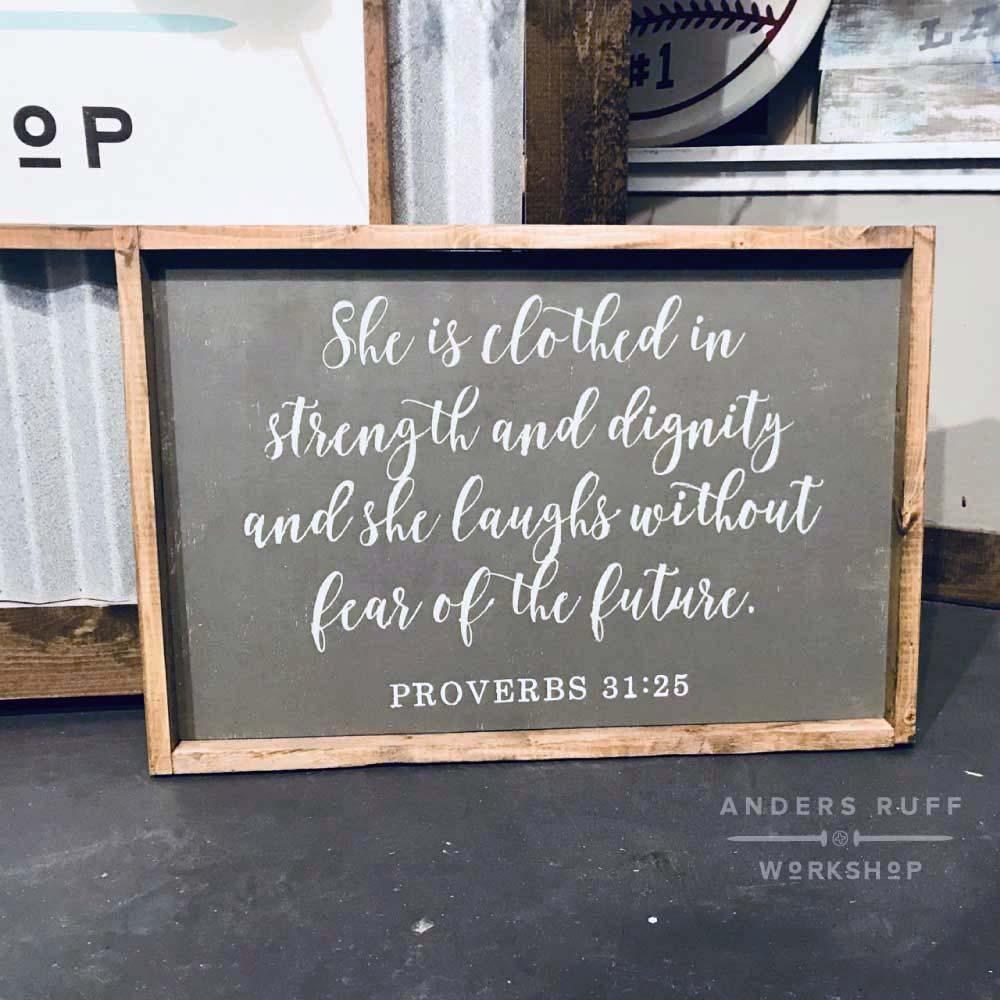 proverbs she is clothed in strength framed sign 18x26