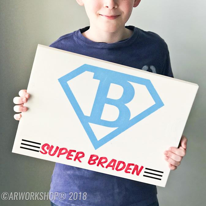 super hero emblem youth plank sign