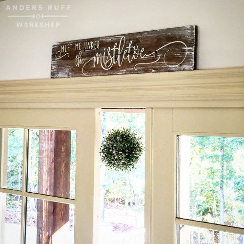 meet me under the mistletoe plank wood sign ar workshop