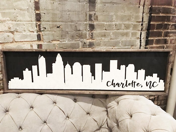 rustic city skyline wood sign