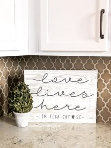 love lives here plank sign 14x19