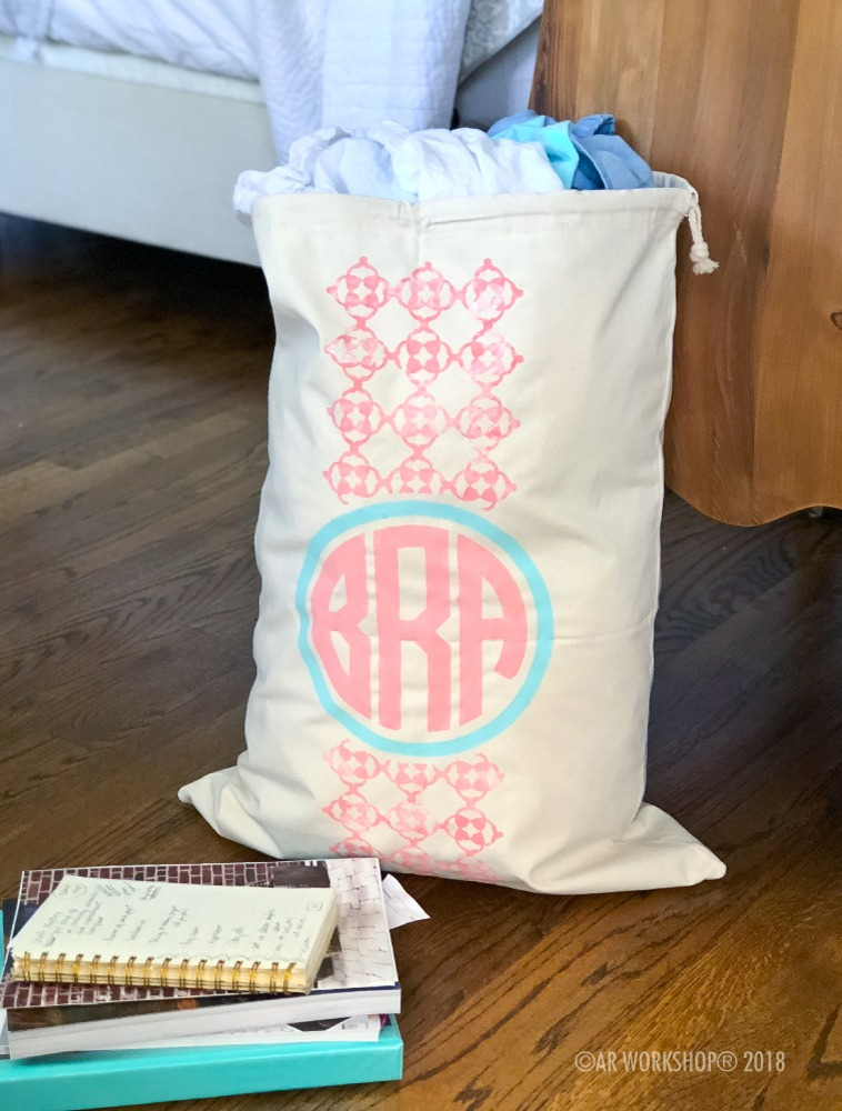 monogram quatrefoil canvas laundry bag