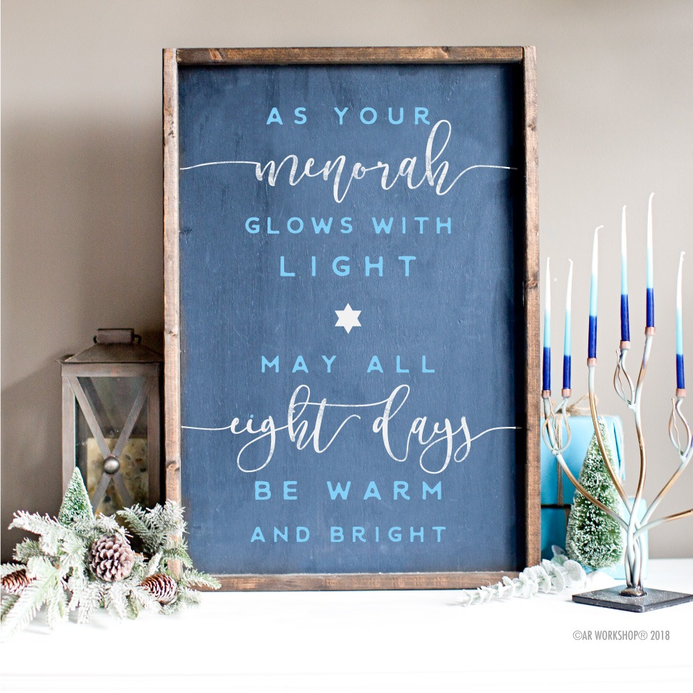 as menorah glows with light framed sign 18x26