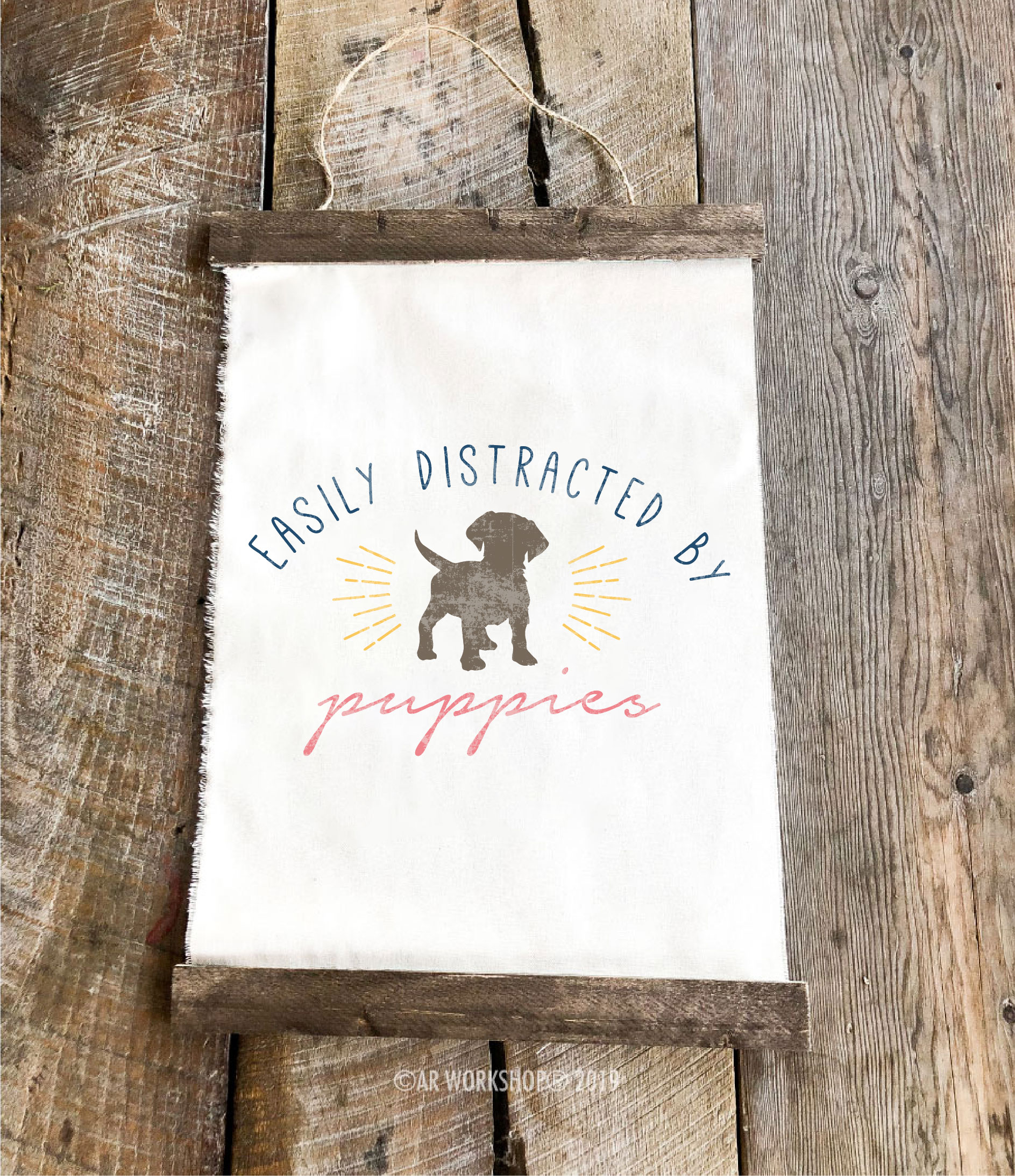 easily distracted by puppies youth canvas hanging