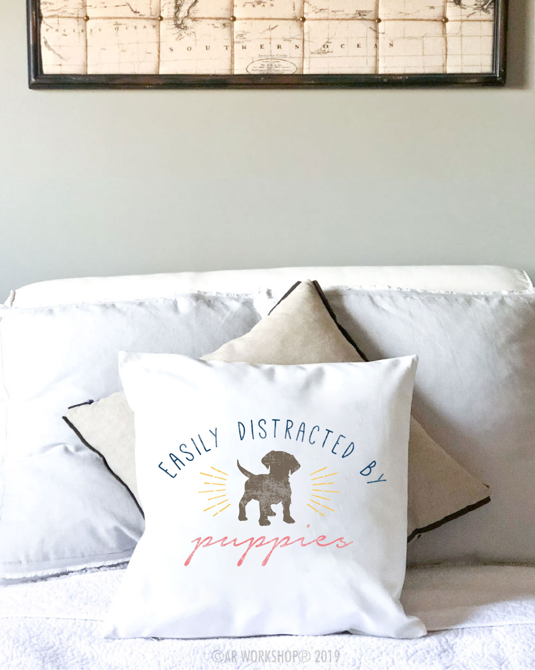 easily distracted by puppies canvas pillow